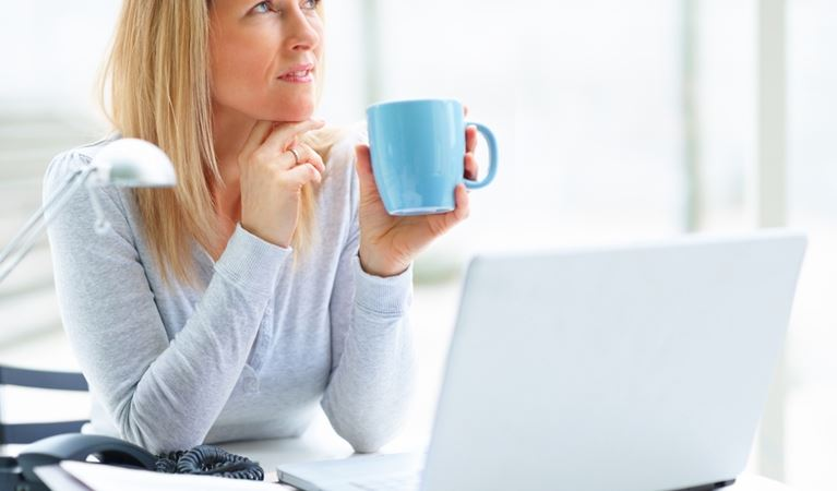 shutterstock 26047456%5b1%5d woman laptop coffee