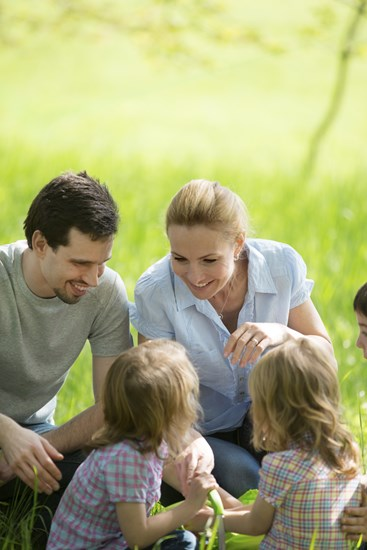 shutterstock 230077735%5b1%5d family taking a break on a meadow